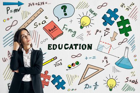 Attractive european businessman with creative education sketch on white wall background. Knowledge and think concept