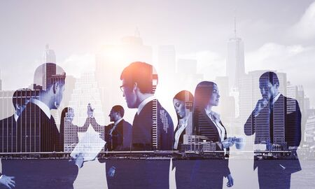 Double exposure of group of business people on the background of the city, cold toning