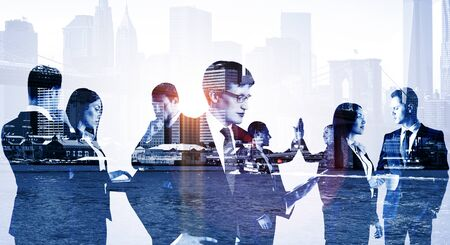 Double exposure of group of business people discuss on the background of the New York city, cold toning