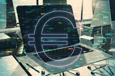 Financial and currency concept with double exposure of big euro sign at abstract statistic background and laptop on the office table.