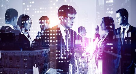 Multi exposure of group of business people working on the background of the city Stock Photo