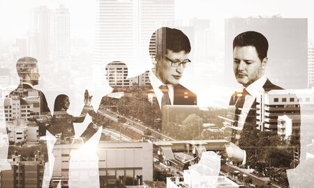Double exposure of group of business people discuss on the background of the city