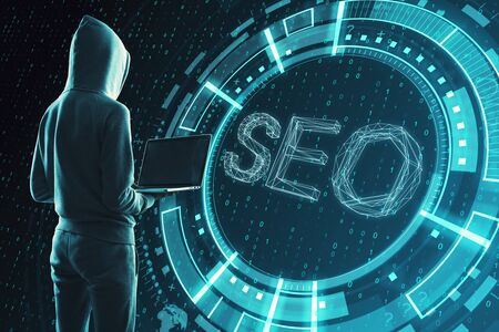 Hacker with laptop and abstract SEO hologram on binary code background. Search engine optimization concept Stok Fotoğraf - 128936339