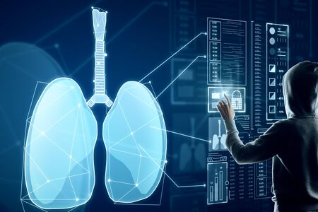 Hacker with abstract glowing blue medical lungs interface background with icons. Medicine and innovation concept. Double exposure Imagens