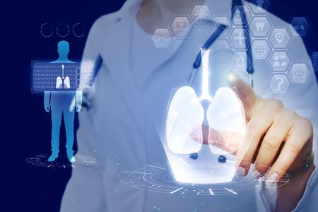 Female doctor with abstract glowing blue medical lungs interface wallpaper with icons. Medicine and innovation concept. Multiexposure