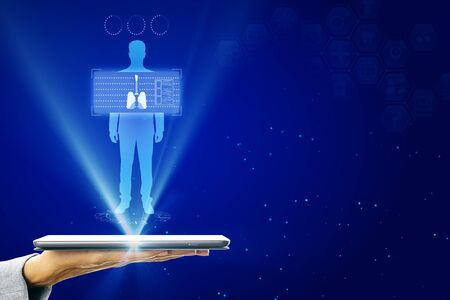 Hand holding tablet with abstract glowing blue medical lungs interface background with icons. Medicine and innovation concept. Stock Photo