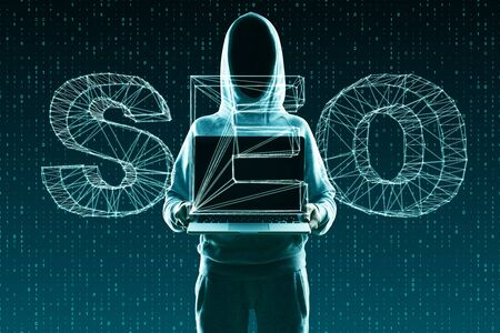 Hacker with laptop and abstract SEO screen on binary code background. Search engine optimization concept. Double exposure