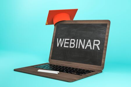 Abstract laptop image with chalkboard and tiny graduation cap on blue background. Webinar and online education concept. 3D Rendering