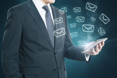 Businessman hand holding smartphone with glowing email network. E-mail marketing, message and communication concept. Multiexposure Stock Photo - 132009434