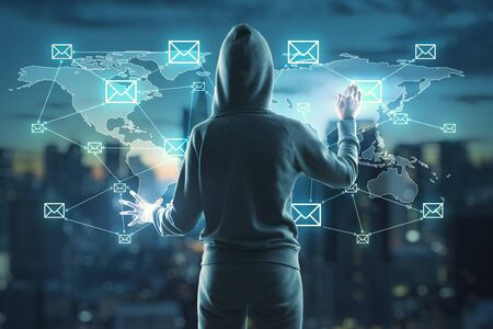 Unrecognizable hacker using abstract padlock social network interface on blurry night city background. Protection and virus concept. Multiexposure