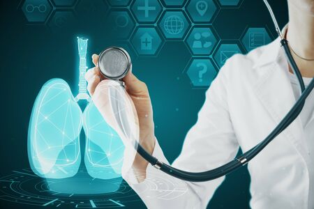 Female doctor with abstract glowing blue medical lungs interface backdrop with icons. Medicine and innovation concept. Double exposure Archivio Fotografico