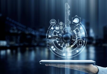 Hand holding tablet with creative digital key hologram on blurry night city background with icons. Access, safety and innovation concept. Double exposure