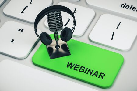Close up of white keyboard with mic and headphones on green webinar button. Online education concept. 3D Rendering