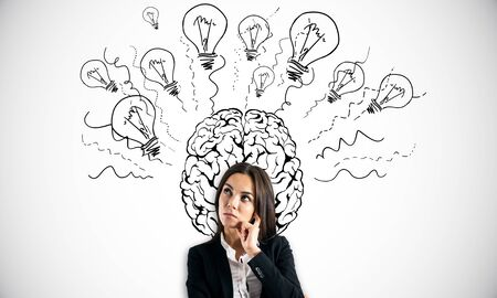 Attractive young european businessman with creative brain and lamps sketch on white background. Brainstorm and idea concept