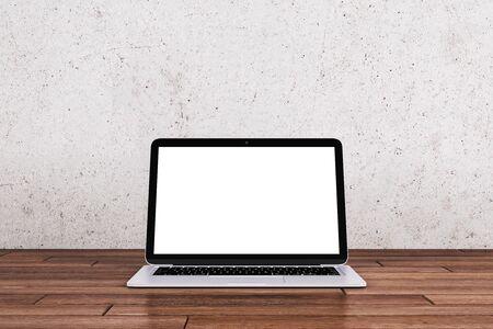 Empty white laptop computer display on wooden desktop and black wall background. Online advertisement concept. Mock up, 3D Rendering Imagens