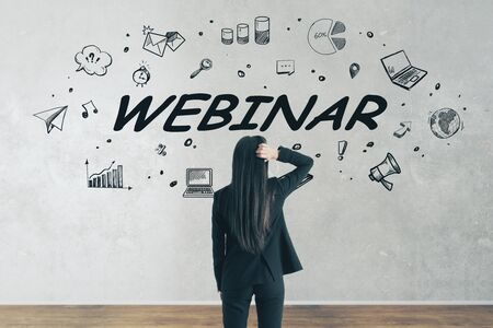 Stressed young businesswoman looking at webinar sketch on white wall background with icons. Internet and presentation concept