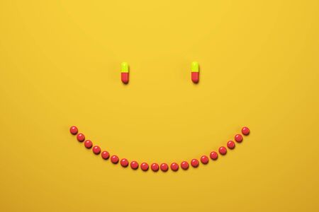 Creative smiling pills on orange background. Medicine and illness concept. 3D Rendering