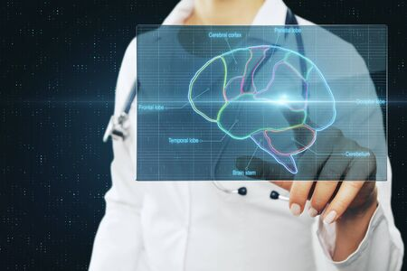 Doctor touching digital screen with medicalbrain reseach picture with brain lobes marked by neon color. Archivio Fotografico - 129592727