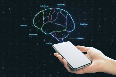 Hand with smartphone screen and digital brain scheme marked by neon lines at abstract background. Reklamní fotografie - 129605080