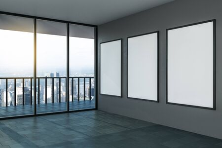 Blank white mock up posters on grey wall in modern empty room with balcony and city view. 3D Rendering