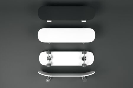 Three blank white and one black skateboards at dark grey background, mock up. 3D Rendering