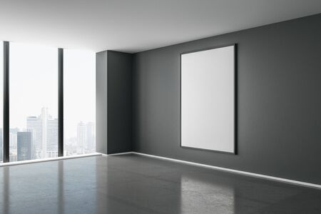 Blank white mock up poster on dark wall in modern empty room with concrete floor and city view. 3D Rendering