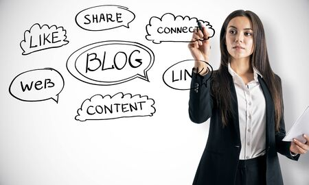 Blogging concept with woman drawing business scheme at light wall background.