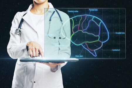 Doctor with digital tablet makes a projection from a computer on digital screen with medical research of human brain results.