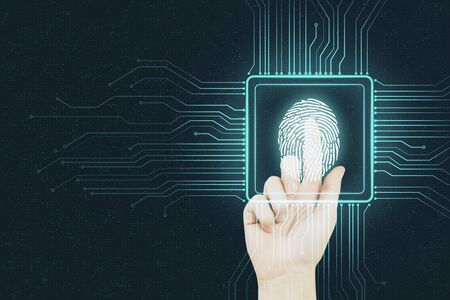 Digital security concept with human finger pushing digital fingerprint in microchip at abstract background.