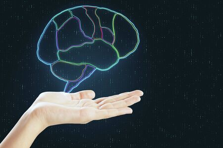 Digital human brain devided by lobes above human hand at abstract background. Stock Photo