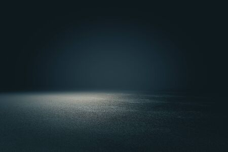 Abstract spacious place with dark wall, granular floor and spot light from above. 3D Rendering 写真素材