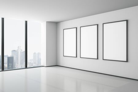 Blank white mock up three posters on white wall in modern empty room with megapolis city view. 3D Rendering