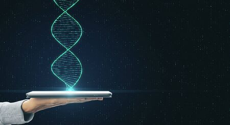Genetic science and biotechnology concept with human hand with digital tablet and dna spiral. Reklamní fotografie
