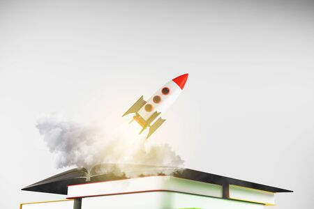 Rocket ship launching off book pile on subtle white background. Startup and knowledge concept. 3D Rendering 版權商用圖片