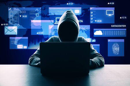 Hacker at desktop using laptop with digital business interface hologram. Big data and virus concept