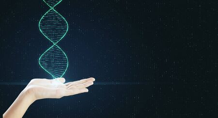 Genetic science and biotechnology concept with human hand with dna spiral at abstract background.