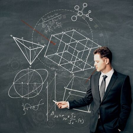 Businessman drawing creative geometric figures sketch on chalkboard background. Geometry. science and education concept