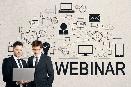 Two handsome european businessmen using laptop with creative webinar sketch on white background. Online education and seminar concept Stock fotó - 130685272
