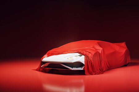 Modern sports car presentation with red cloth. Design and exhibit concept. 3D Rendering