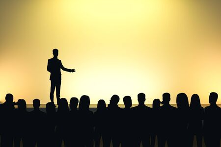 Businessman giving speech in front of backlit audience on light yellow background. Speaker and motivation concept