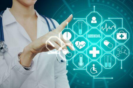 Medicine and tech concept. Doctor hand using creative glowing blue medical interface on dark background. Multiexposure Reklamní fotografie