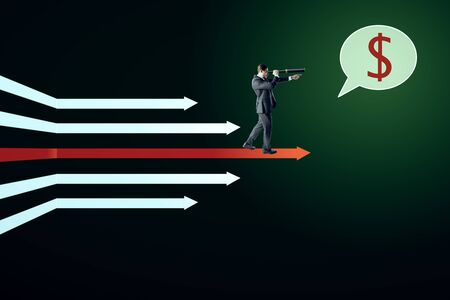 Businessman with telescope and dollar sign standing on digital white arrows on dark green background. Money, vision and growth concept. 写真素材