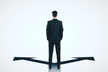 Back view of businessman with arrows on white background. Different direction and choice concept Standard-Bild