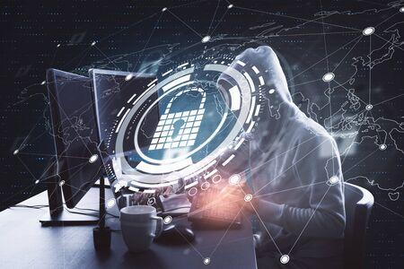 Hacking and password concept. Hacker at desktop using laptop with glowing padlock hologram in dark background. Multiexposure