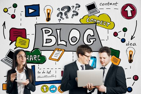 Success and blog concept. Attractive european businesspeople using laptop together on creative colorful business sketch wall background