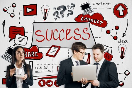 Idea and teamwork concept. Attractive european businesspeople using laptop together on creative colorful business sketch wall background