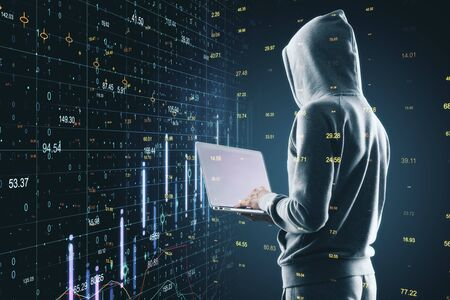 Side view of hacker using laptop with abstract big data hologram. Technology and innovation concept. Multiexposure  Zdjęcie Seryjne
