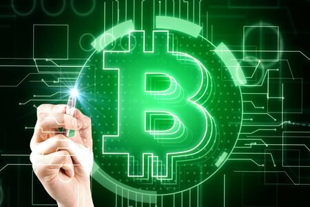 E-business and money concept. Hand using lowing green bitcoin interface in blurry dark wallpaper. Double exposure  Zdjęcie Seryjne
