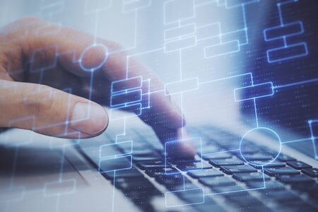 Close up of hand using laptop with creative glowing big data block chain background. Cryptocurrency and software concept. Double exposure