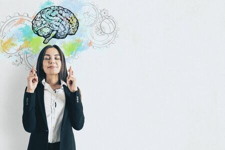 Businesswoman crossed her fingers for success. Abstract brain and gears. Perspective and intelligence concept.